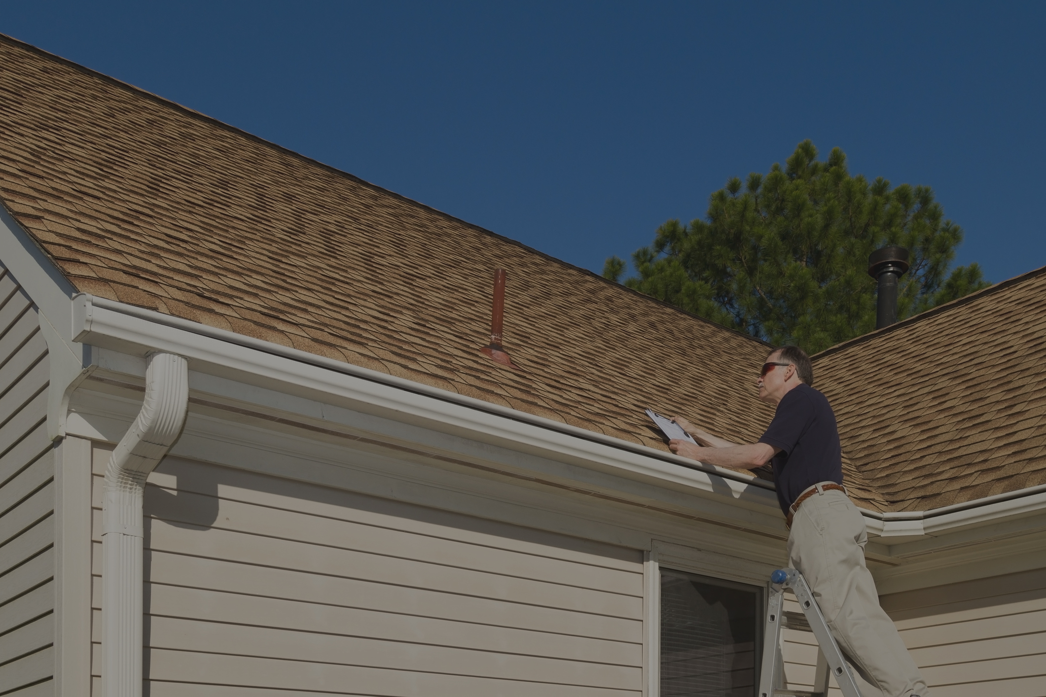 Home Inspector Performing Roof Inspection
